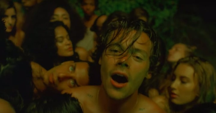harry styles is back and his new video is sexy as hell