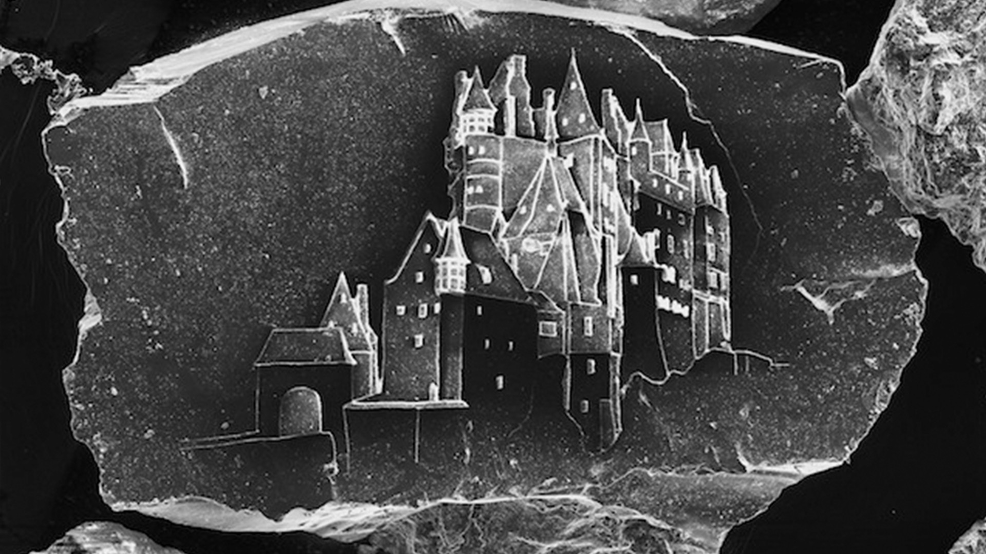 Etching Sand Castles on a Single Grain of Sand