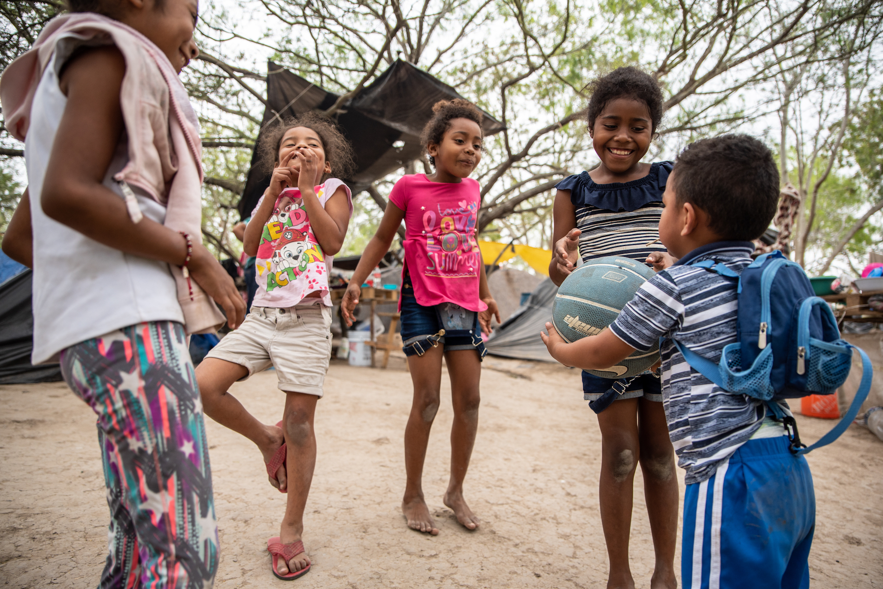 A group of children play