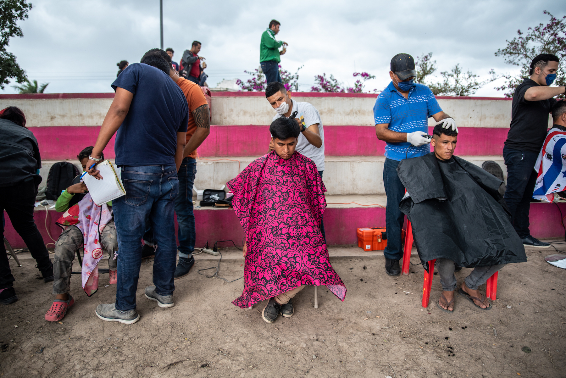 A group of barber shop students offer free haircuts to migrants staying at the camp in Matamoros.