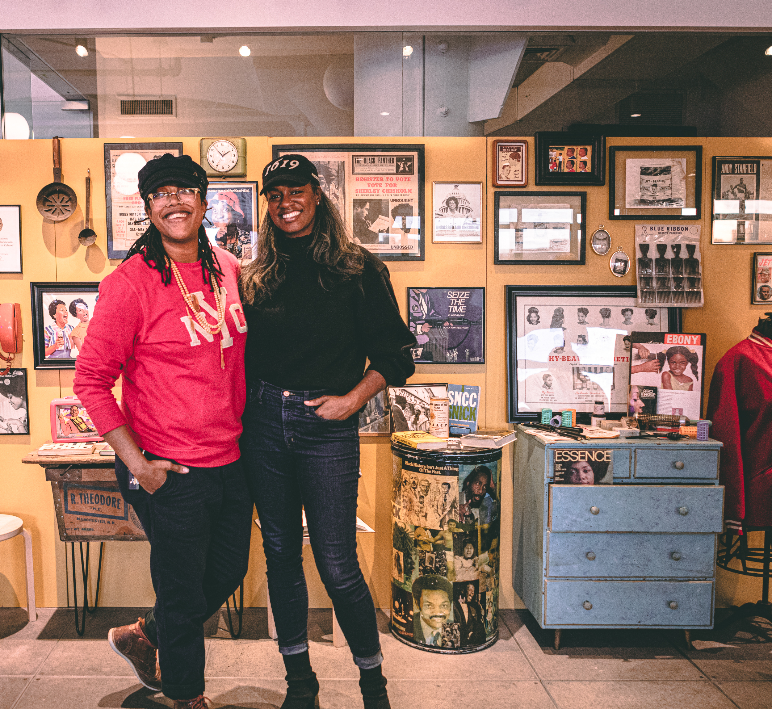 BLK MKT Vintage founders, Jannah Handy (left) and Kiyanna Stewart (right) posing in front of an exhibit they curated at NYC ad agency, Wieden + Kennedy in February 2020.