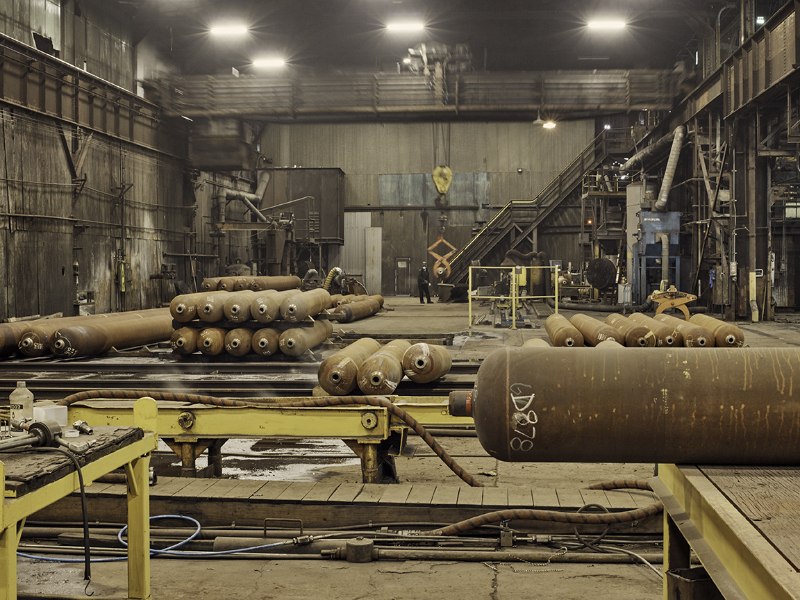 large metal tubes in a factory