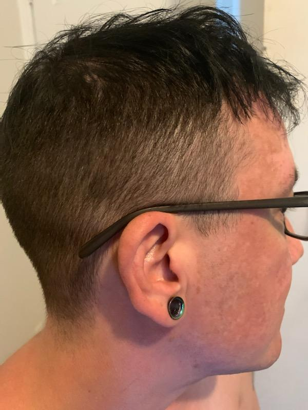 person showing off short haircut from the back
