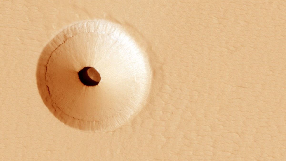 NASA Found an Unusual Hole on Mars That Scientists Say Could Contain Alien Life