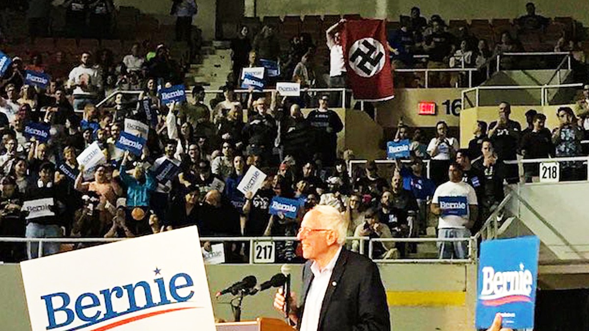 Bernie Seemed Pretty Unfazed by This Asshole Dropping a Nazi Flag at His Rally